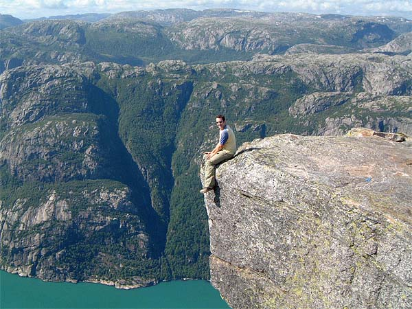 Some crazy nutter sitting above Kjerag and Lysefjord (photo by Jamie Lowe, apparently).