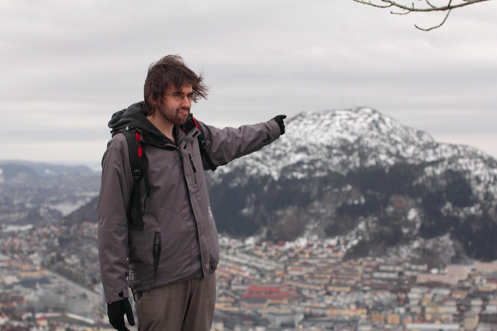 Seb, up Floibanen in Bergen, pointing in the direction of his new house.