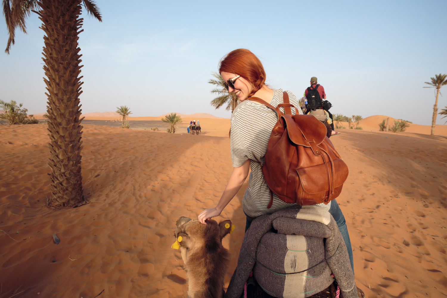 Shannon on Shirley the camel, in Merzouga, riding out onto Erg Chebbi