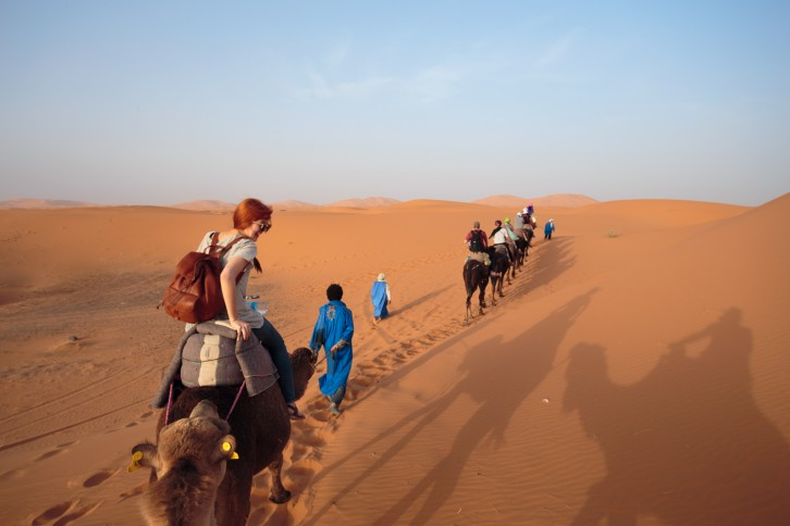 Shannon, Shirly, our Berber guide, and the rest of our camel caravan