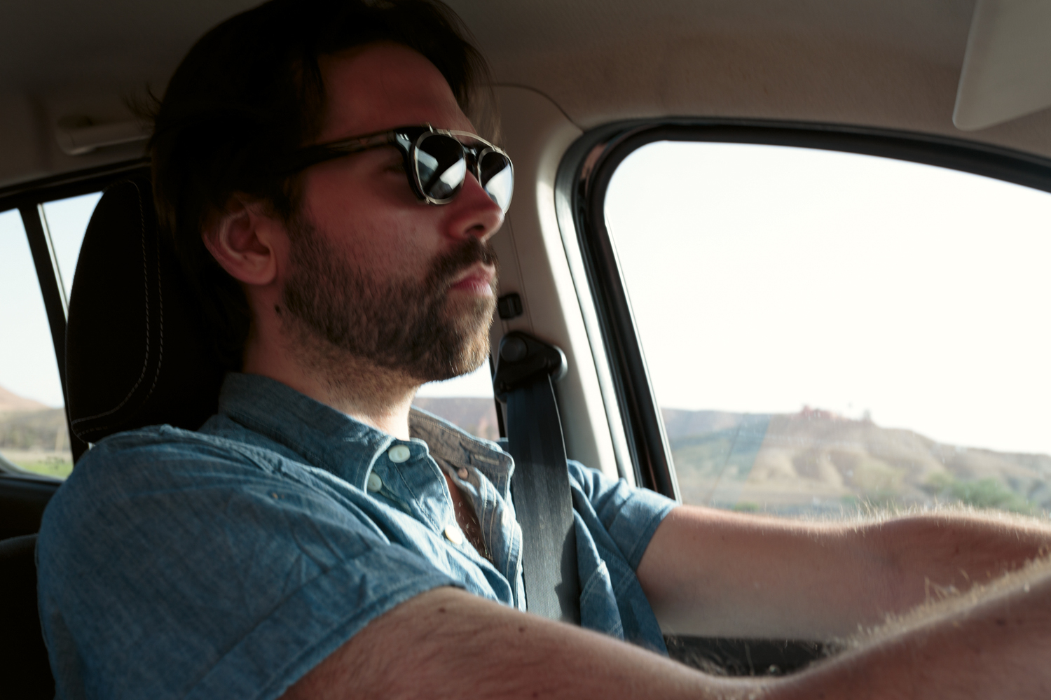 Me, driving a rental car, somewhere in the Moroccan desert