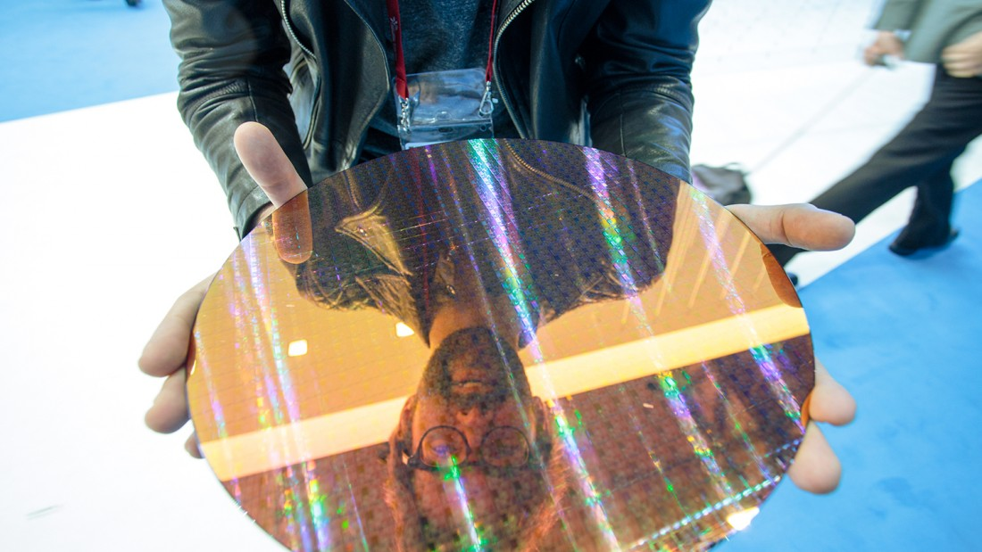 Me (Sebastian) holding a 22nm Intel wafer at MWC